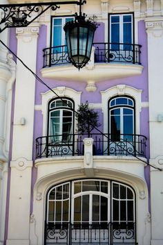 Lisbon Portugal building with Purple walls & Turquois windows.