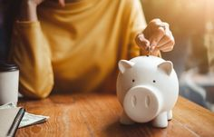 woman hand putting money coin into piggy for saving money wealth and financial concept. - Buy this stock photo and explore similar images at Adobe Stock Financial Stress, Financial Goals, Financial Analyst, Financial Assistance, Financial Planner, Money Tips, Money Saving Tips, Money Budget, Money Plan