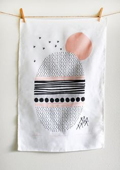 This is a 100% linen tea towel with Leahs underneath the stars design. It is screen printed with water-based black and peachy pink ink on white linen.