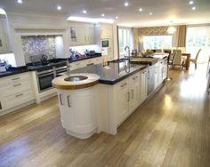 photo of contemporary fresh large open plan beige black white kitchen kitchen diner with flooring island kitchen island