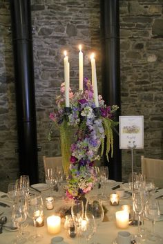 Our Verdi Gris Candelabras swathed in a garland of watercolour bounteousness