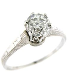 Vintage 14k white gold engagement ring set with a round brilliant diamond weighing 1.00ct of I1 clarity and H color.
