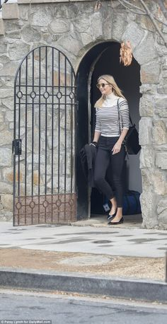 Ivanka Trump is seen flashing a smile as she departs her home in Washington, D.C. Sunday...
