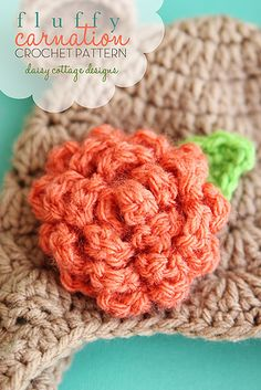 Crochet a carnation using Vanna's Choice. Pattern and tutorial by Daisy Cottage Designs.