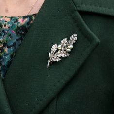 Royal Christmas 2015  The brooch, with higher resolution, is apparent that rather than a solid gold leaf, there are little pearl acorns attached to diamonds along the brooch.