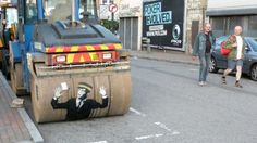 Steam roller VS. Traffic Warden Roller won, so people can ! Banksy