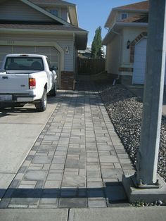 18' wide in front of garage 11' wide at narrowest 3' pavers on one side 4' pavers on otherside (closest to house) Fit 2 Cars side by side on driveway