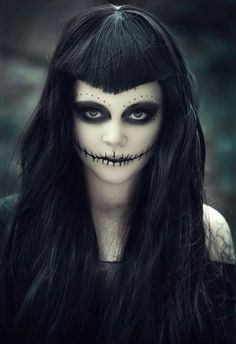 skeleton face paint with stitched lips and black eyes