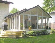 A Glastar three-season sunroom with gable roof in Charleswood. Four Season Sunroom, Three Season Room, Sunroom Addition, Real Estate Articles, Card Table Wedding, Gable Roof, Best Windows, Extruded Aluminum