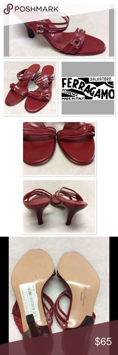 5.5B  FERRAGAMO  Red Leather Sandals Floor model shoe has some scuffing to backs of footbeds but nothing major. These have been sitting in a closet for several years, unworn and waiting to make a come back! These are super adorable and feature the Ferragamo shaped silver hardware. Salvatore Ferragamo Shoes Heels