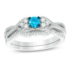 1/2 CT. T.W. Enhanced Blue and White Diamond Tri-Sides Twist Bridal Set in 10K White Gold  http://www.zales.com/product/index.jsp?productId=117037476&camp=PLA-GOO-PLA+-+NB+-+Bridal-Bridal-259781655496_product_type_bridal_product_type_bridal_sets_product_type_diamond&allowpop=no&utm_source=pla&adpos=1o36&creative=192802924945&device=c&matchtype=&network=g&product_id=20087820&gclid=EAIaIQobChMInOnOv9C31QIVUFmGCh0PUQxrEAkYJCABEgJ0tPD_BwE