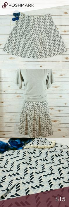 """Old Navy just below the waist patterned skirt This skirt sits just below the waist. It has a pattern that includes cream, light blue, & navy. There is a half zipper on the side. Waist is approx 32"""", length is approx 20"""". All measurements taken unstretched. 100% cotton Old Navy Skirts Midi"""