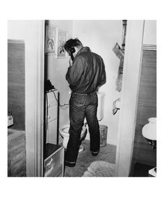 James Dean in Restroom - Frank Worth Photography