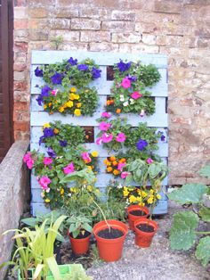 Pallet Planter...funky, but cute.