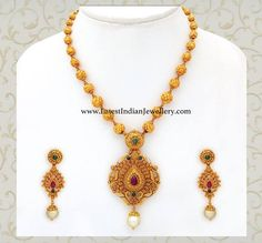 Jewelry OFF! Beautiful gold haram with gold balls chain attached to intricately worked antique gold pendant and paired with gold long earrings Gold Earrings Designs, Gold Jewellery Design, Necklace Designs, Gold Designs, Gold Haram Designs, Antique Jewellery, Antique Necklace, Bead Jewellery, Mehndi Designs