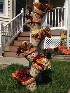 Terra cotta pots painted and then dropped down a dowel rod. Stuff with silk flowers :) can also make snowmen for winter????