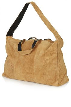 Topshop Embossed Suede Luggage Bag in Tan, £80. Also comes in Black. I love this very much. However, I have not seen it in real life yet (22/09/14) and would like to inspect the quality.