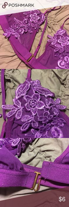 Pretty purple unlined bra This oh so cute bra is gently loved and so great fitting! This garment hugs.every.curve. And has the cutest flowers to cover your sensitive areas. This bra clasps in the front and has a very thin razorback. Urban Outfitters Intimates & Sleepwear Bras