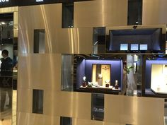 Metal and glass display wall
