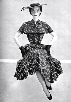 Adele Simpson dress from 1952. Looks as tightly corseted as a similar gown might have been in 1890. Rather a schoolmarmish air. Very 50s.