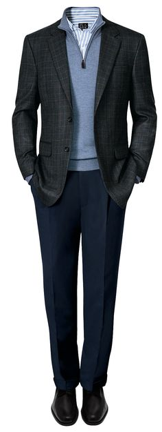 Keep warm and stylish this winter by layering an Executive Windowpane Sportcoat with a half-zip sweater.