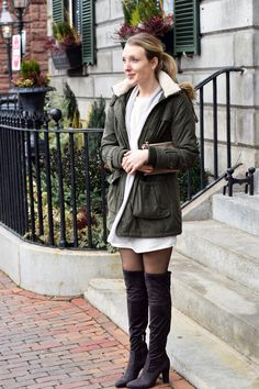 fur lined jacket, lace panel dress, over the knee boots