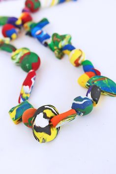 Learn how to make simple colorful beads with polymer clay. Perfect for kids to try!