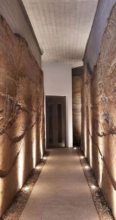 This modern house has a tunnel that runs through a sandstone cut corridor that leads from the garage to the stairs (and lift) inside. #Tunnel #Architecture #Sandstone