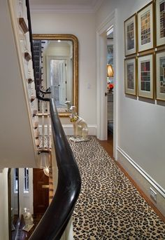 Leopard stair runner rolling through a gorgeously done stair hall in a completely renovated Brooklyn Heights townhouse by CWB Architects.