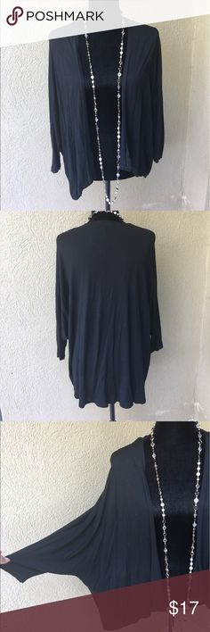 🆕Cotton On Black dolman sleeve  shrug This black loose fitting open front medium length shrug is a closet staple! Need a quick throw over for an evening outside when it gets cooler, need something to cover your bare shoulders at the office- just need a casual chic addition to your outfit? This is the piece!! Longer in the back drapes in the front. EUC Material content tag has been removed- feels like tshirt material ✅I ship same or next day ✅Bundle for discount Cotton On Sweaters Shrugs…