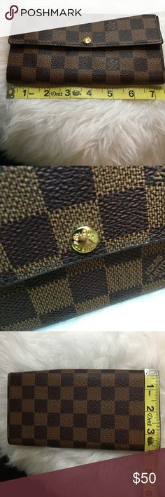 Beautiful Wallet Beautiful brown and dark brown wallet, with a hint of red. Gold hardware. Measurements are shown in pictures above. Price reflects authenticity. If you have any questions, leave me a comment and I will respond right away. I will take reasonable offers. Thank you and have a great day Bags Wallets