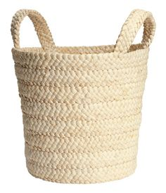 Pillows, throws... everything gets tossed in a storage basket to keep your living area tidy