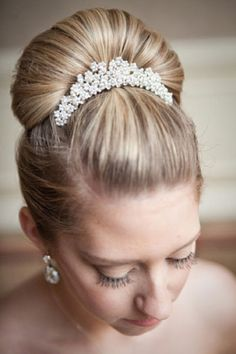 Bridal comb highlights a ballerina bun.