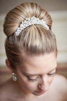 Bridal comb highlights a ballerina bun.