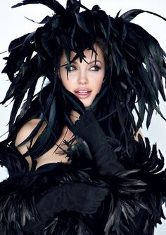 Well, if you ask me, it looks like some huge crow died and moulted all over her! Simply hideous! and I'm not just talking about Angelina here! LOL    Patrick Demarchelier for Vanity Fair - Angelina Jolie