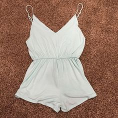 Blue romper  Plunging in the front and back, blue romper. Cute to wear out or as a cover up  Honey Punch Pants Jumpsuits & Rompers