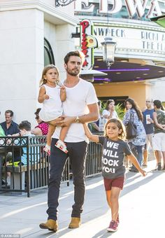 Clean-cut: The newly single father-of-three looked trendy in a plain white T-shirt paired ...