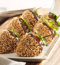 Chocolate nut strawberries.Delicious juicy strawberries dipped in chocolate and coated with chopped almonds.