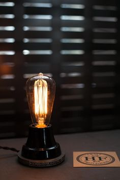 On the entry table, Schoolhouse Electric'sIon Lamp in black porcelain.