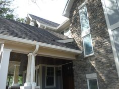another angle on the front of the house highlighting the custom porch ceiling (stained pine car siding) and the lap siding (James Hardie Gray Slate Board & Batten). Slate Board, James Hardie, Board And Batten Siding, Porch Ceiling, New Construction, St Louis, Pine, Windows, Gray