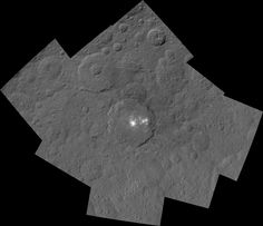 A mosaic by NASA's Dawn spacecraft shows Ceres' Occator crater and surrounding terrain from an altitude of 915 miles (1,470 kilometers. Image released Oct. 26, 2015.