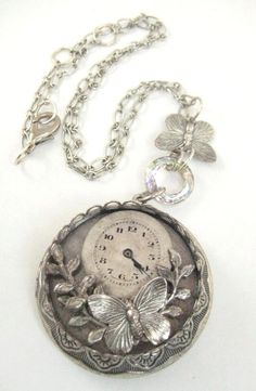 Locket! I do not like wrist watches. This one is not in stock but I love it and you can find similar ones.  The hobby lobby supplies them if you like costume jewelry.  I can't wear costume jewelry due  to metal allergy I can only wear gold or white gold or I would buy several.