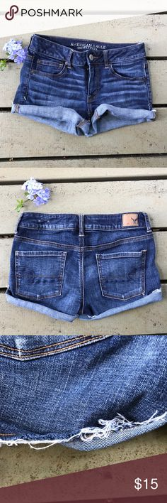 American eagle shorts Dark color. Good contain! No stains or holes. The bottom is not stitched up. I usually fold it up and iron it. Can be worn either way. Picture 3 shows how the bottom of it looks American Eagle Outfitters Shorts Jean Shorts