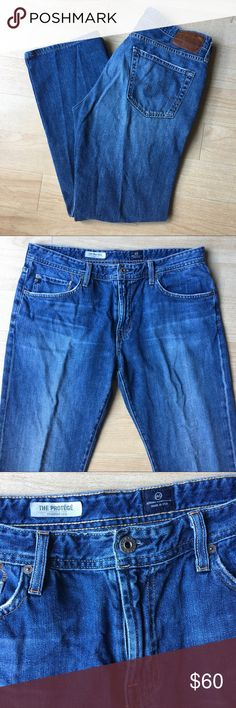 "AG Adriano Goldschmied Protege Straight Jeans 36 Excellent Condition. AG Jeans. Style is 'The Protege' which is a classic Straight Leg Jean. Color is a mid wash blue with light whisker details and fading for a worn in look. These jeans are soft and 'broken in'. 75% Cotton 25% Lyocell. Size 36x34  Approx measurements  Rise 11"" Inseam 32"" Waist 36"" Hem opening 18""  (52/B2) Ag Adriano Goldschmied Jeans Straight"