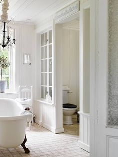 White bathroom | glass screen door divider | french cottage country style