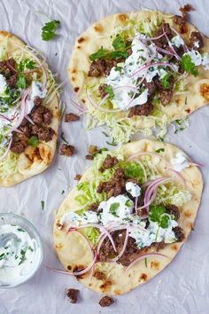Naanwich Naan Wraps with Homemade Cucumber Raita Recipe. This quick, easy, and unique weeknight meal is SO SIMPLE to make. Great if you're looking for ideas for dinners and meals to try this week. You'll need onion, ground beef or lamb, naan bread, whole milk yogurt, cucumber, mint, cilantro, coriander, lettuce, and onion. Try a naanwich this week!