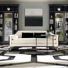 Geometric floor. Caracole sofa. Black and white palette with a splash of green.