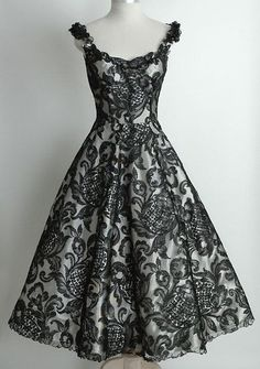 Lovely alternative to the traditional white weddng gown.  Lace Black 1950's Vintage Dress by Digirrl (If anyone knows a website where this can be purchased from, please comment).