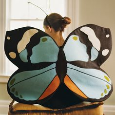 Colorful and beautifully crafted, hand-stitched felt wings can turn anyone into a bright butterfly. Combine them with a plain black top and pants, and a headband with pipe-cleaner antennae.