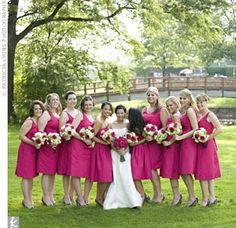 To stand out from the rest of the bridal party, the maid and matron of honor wore strapless cotton tea-length dresses. The bridesmaid dresses were the same hue, but they had straps.